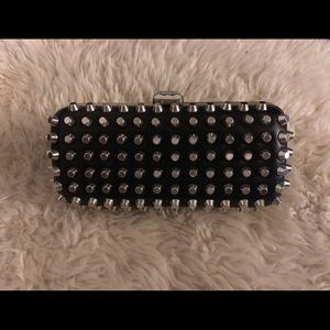 Studded clutch with snap closure.